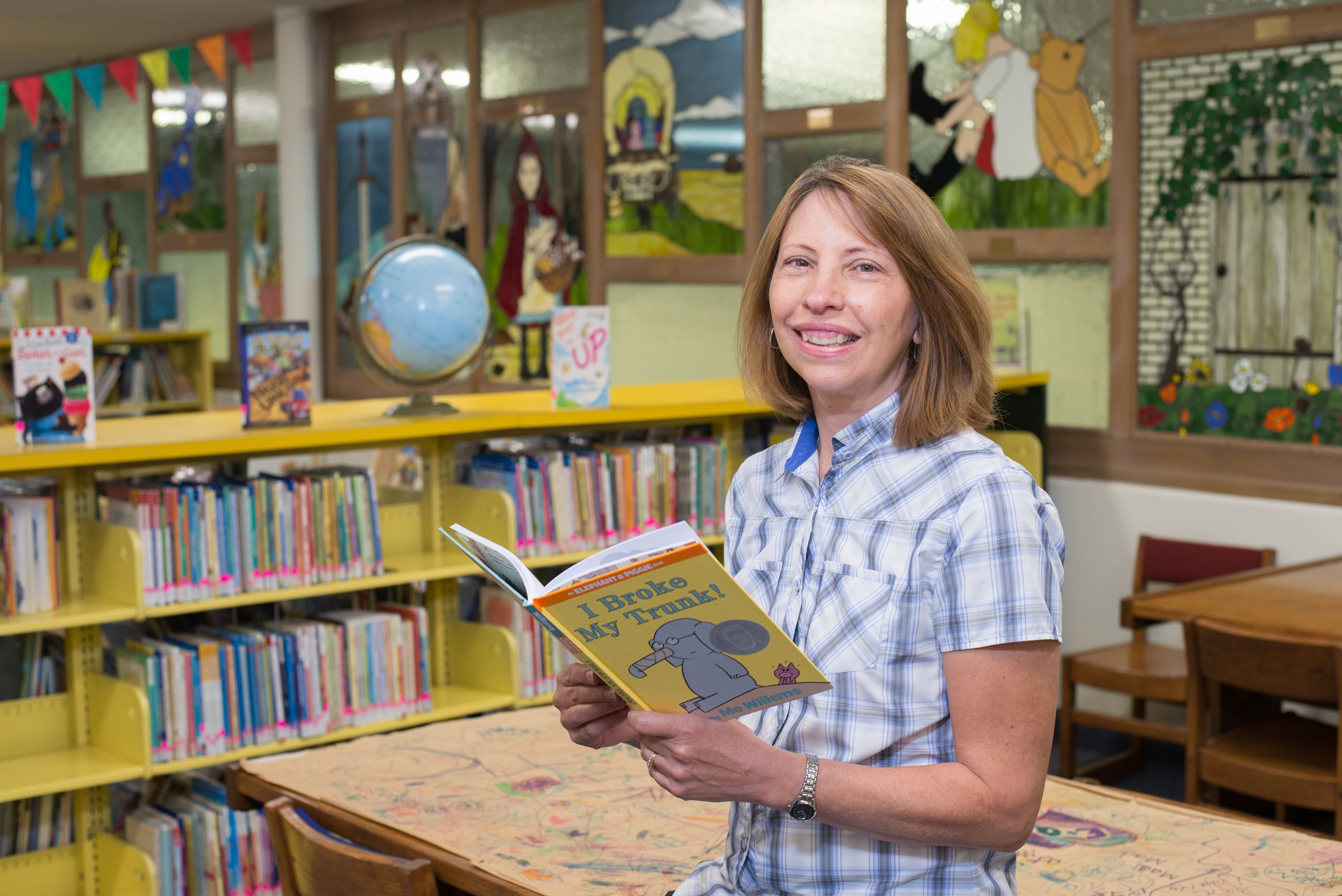 Image of librarian holding children's book