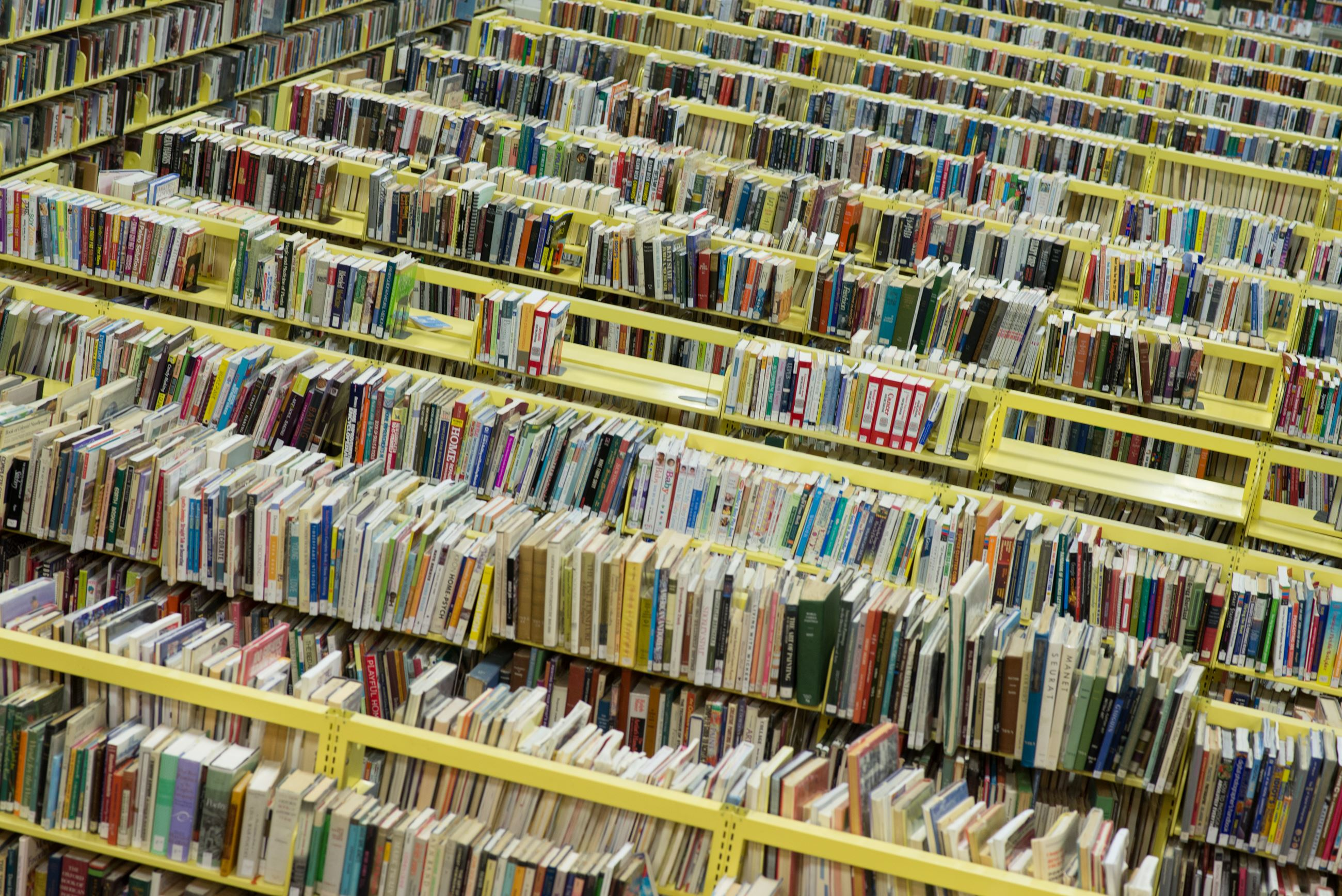 Image of rows of bookshelves from above